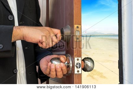 businessman open the door by key to the beach - can use to display or montage on products