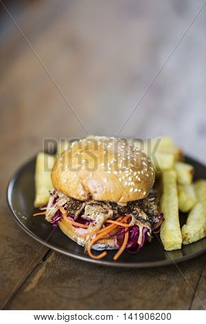 pulled pork and coleslaw burger with thick fries