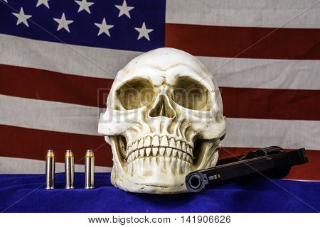 human skull on blue with three bullets and 357 magnum revolver with american flag background
