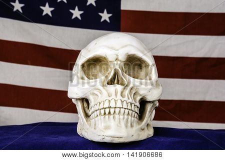 human skull on blue background with american flag background