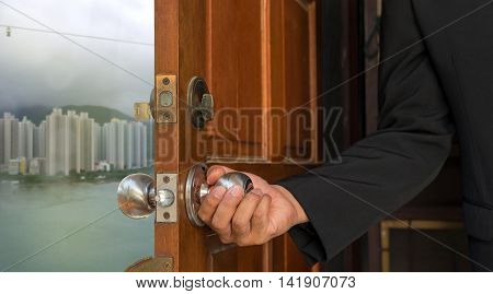 businessman open the door to new world building and sea on hong kong - can use to display or montage on products