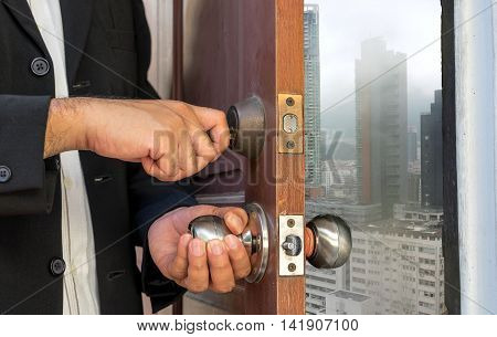 businessman open the door by key to city in rainy - can use to display or montage on products