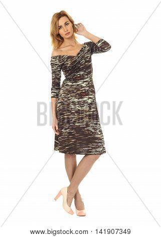 Fashion model wearing khaki cocktail dress on white