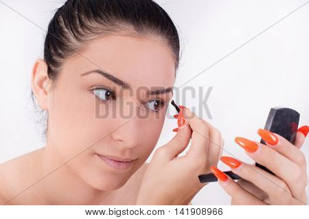 Girl Applying Makeup On Eyebrows