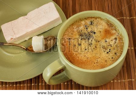 Cup of coffee marshmallow in ceramic ware