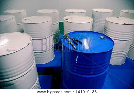 Group of barrels with chemistry at factory workshop