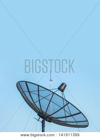 Closeup satellite dish on beautiful clear blue sky textured background with copy space