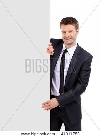 Portrait of businessman showing banner.