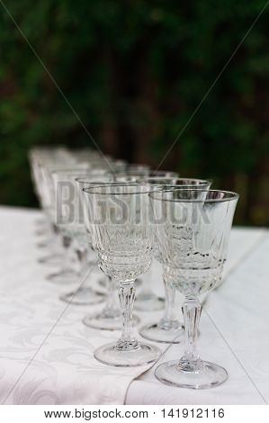 The Line Of Empty Stemware At The Table In Restaurant.