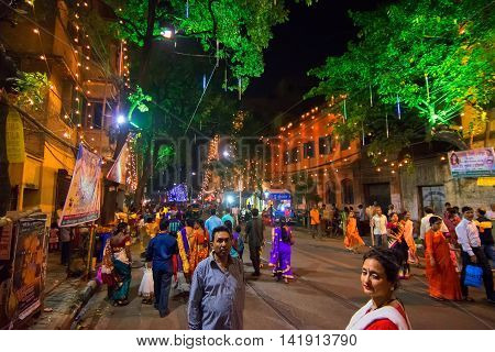 KOLKATA INDIA - OCTOBER 18 2015 : Night image of decorated street of Kolkata shot at colored light during Durga Puja festival West Bengal India. Durga Puja is biggest religious festival of Hinduism.