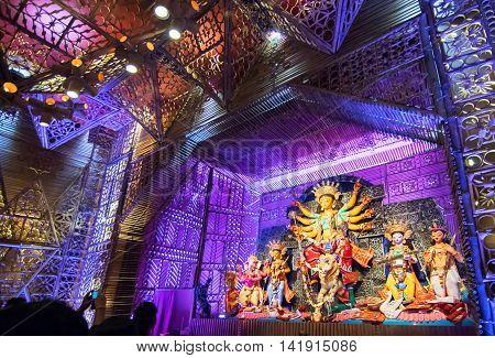 KOLKATA INDIA - OCTOBER 18 2015 : Night image of decorated Durga Puja pandal shot at colored light at Kolkata West Bengal India. Durga Puja is biggest religious festival of Hinduism.
