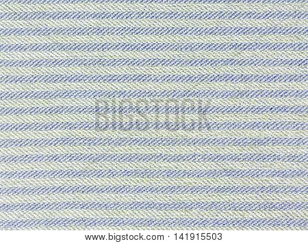 Closeup surface fabric pattern at the old and pale blue fabric mat at the floor of house texture background