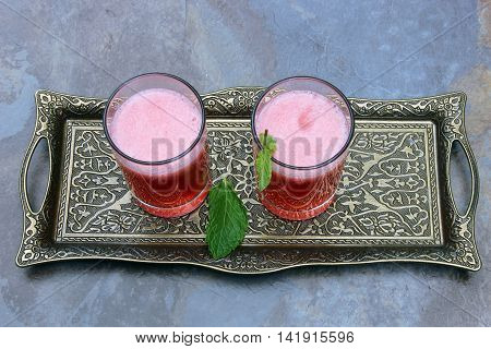 A tray with two glases pf plum lemonade with copy space