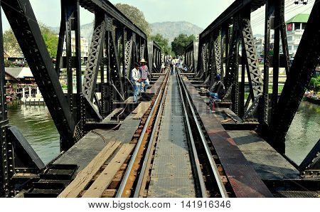 Kanchanaburi Thailand - December 24 2010: View along the tracks of the legendary railway Bridge on the River Kwai immortalised in the classic 1957 David Lean movie