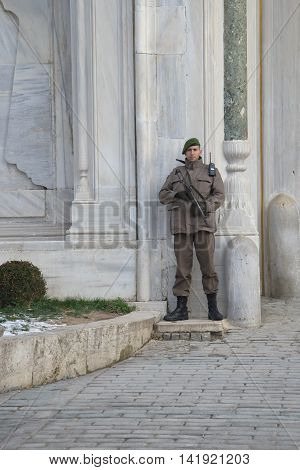 ISTANBUL, TURKEY - JANUARY 09, 2015:A Turkish soldier is guarding the Topkapi Palace