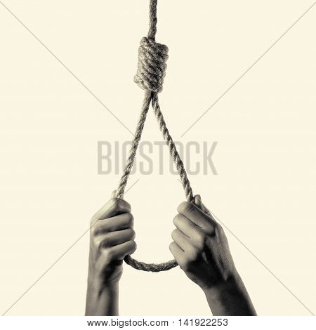 hands hold the hanging Lynch's loop, isolated