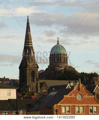 NEW BRIGHTON, ENGLAND, JUNE 29. St James' Church and St Peter and St Paul's Church on June 29, 2016, in New Brighton, England. St James' Church and St Peter and St Paul's Church dominate the skyline in New Brighton England.