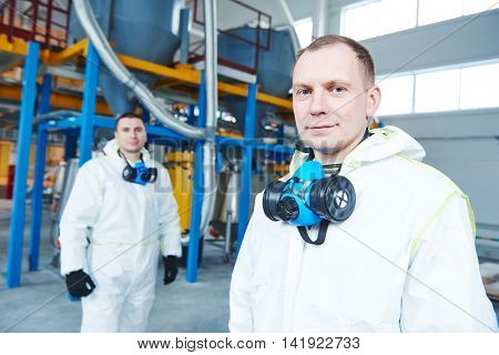 chemical industry workers at factory