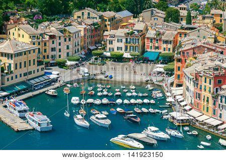 Pleasure boats and yachts in the harbor village of Portofino. Italy. Liguria. Cinque Terre.