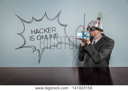 Hacker is online text with vintage businessman kissing machine