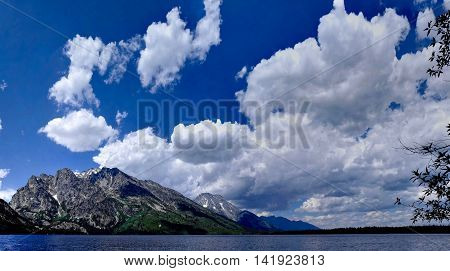 Landscape with mountains, clouds and lake. Grand Tetons National park Moose Wyoming USA.
