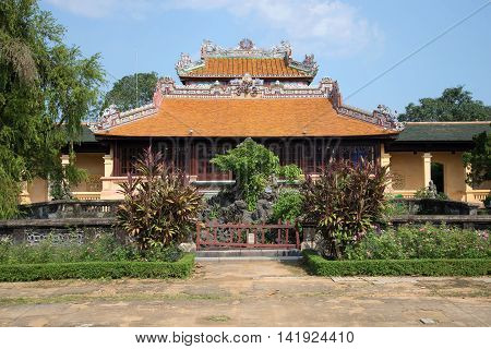 The old reading of the Imperial pavilion Thai Binh in forbidden Purple city on a sunny day. Hue, Vietnam