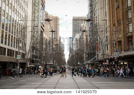 MELBOURNE AUSTRALIA - JULY 18 2016 : Unidentified people walk in Melbourne city Victoria Australia.
