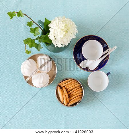 Tea time with zephyr and cookies in vintage bowls. Top view