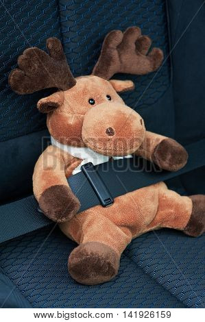 Toy with a seat belt in auto seat