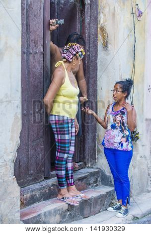 HAVANA CUBA - JULY 18 : Cuban people stand in old Havana street on July 18 2016. The historic center of Havana is UNESCO World Heritage Site since 1982.
