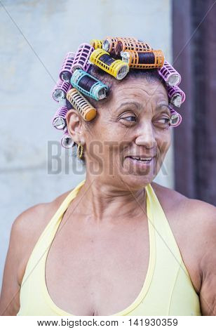 HAVANA CUBA - JULY 18 : A portrait of a Cuban woman in old Havana street on July 18 2016. The historic center of Havana is UNESCO World Heritage Site since 1982.