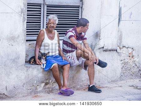 HAVANA CUBA - JULY 18 : Cuban people in old Havana street on July 18 2016. The historic center of Havana is UNESCO World Heritage Site since 1982.
