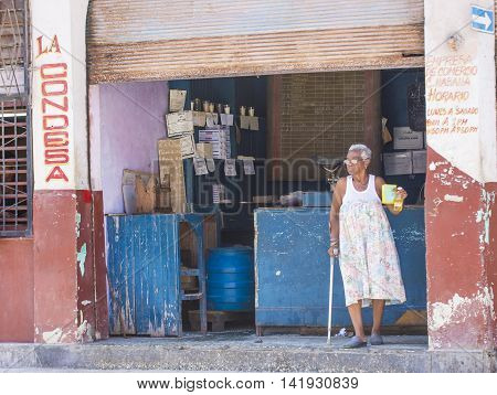 HAVANA CUBA - JULY 18 : A Cuban food seller in old Havana street on July 18 2016. The historic center of Havana is UNESCO World Heritage Site since 1982.