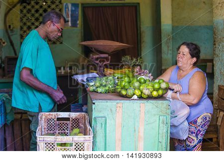 HAVANA CUBA - JULY 18 : A Cuban fruits seller in old Havana street on July 18 2016. The historic center of Havana is UNESCO World Heritage Site since 1982.