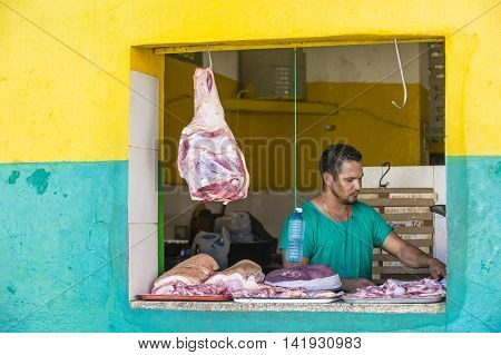 HAVANA CUBA - JULY 18 : A Meat shop in old Havana street on July 18 2016. The historic center of Havana is UNESCO World Heritage Site since 1982.