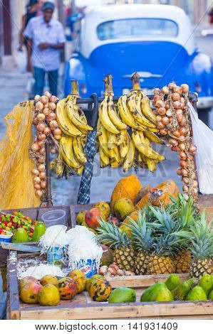 HAVANA CUBA - JULY 18 : A fruits stand in old Havana street on July 18 2016. The historic center of Havana is UNESCO World Heritage Site since 1982.