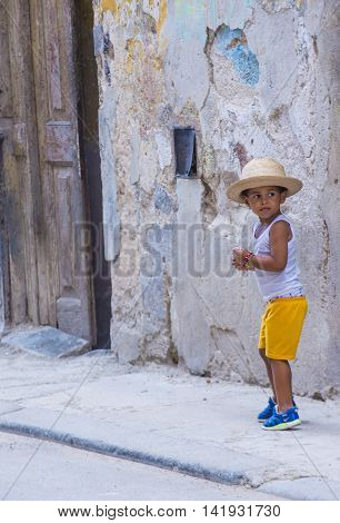 HAVANA CUBA - JULY 18 : A portrait of a Cuban child in old Havana street on July 18 2016. The historic center of Havana is UNESCO World Heritage Site since 1982.