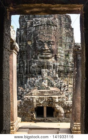 Huge carved Buddha face of Bayon temple at Angkor Wat complex Siem Reap Cambodia