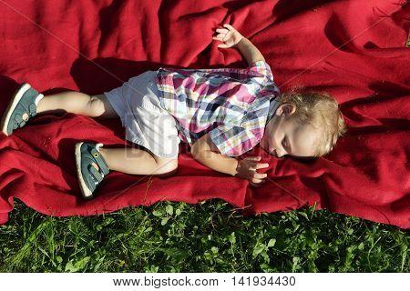 Child Sleeping On Rug