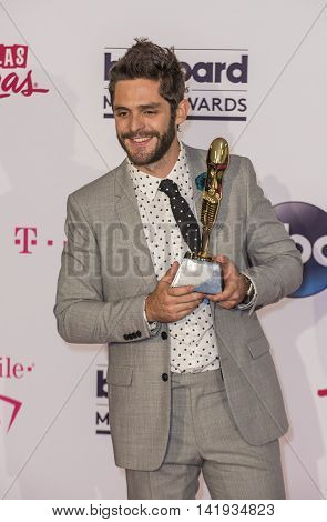 LAS VEGAS - MAY 22 : Recording artist Thomas Rhett winner of the Top Country Song award poses in the press room at the 2016 Billboard Music Awards at T-Mobile Arena on May 22 2016 in Las Vegas