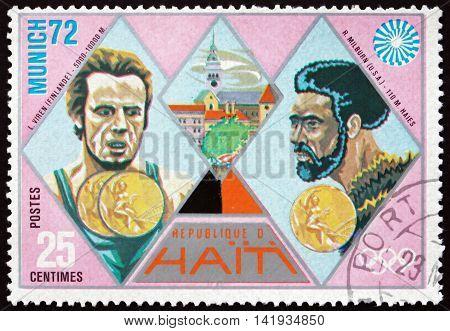 HAITI - CIRCA 1972: a stamp printed in Haiti shows Viren and Milburn Gold Medal Winners 1972 Summer Olympic Games Munich circa 1972