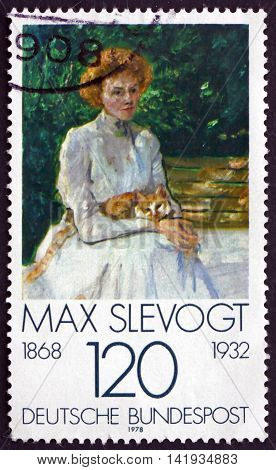 GERMANY - CIRCA 1978: a stamp printed in Germany shows Lady with Cat Painting by Max Slevogt German Impressionist Painter circa 1978