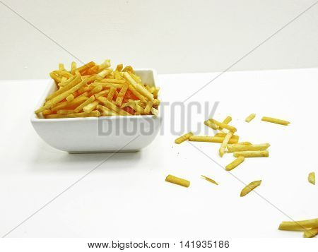 French fries in white plate isolated on white background.