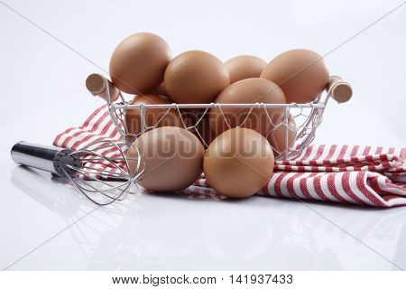 basket of the eggs and the wire whisk