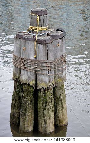 Bollard on a wharf. Ship's rope may be secured to bollard