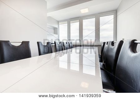 Empty meeting room in white color .