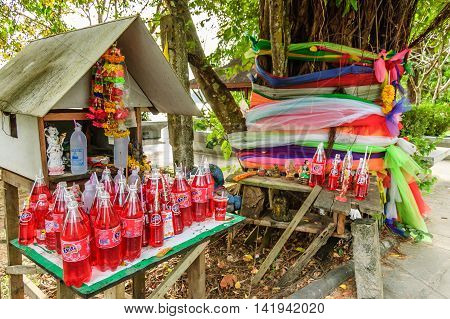 Hat Noppharat Thara, Thailand - December 22, 2012: Beachside spirit house with offerings at Hat Noppharat Thara, Krabi Province, southern Thailand