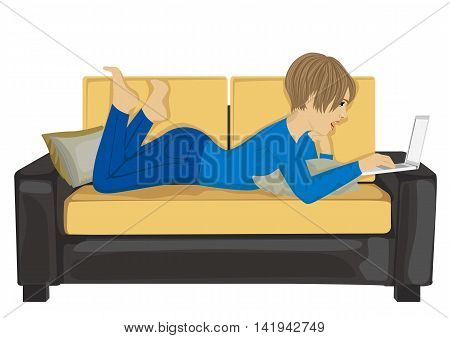 young woman using laptop laying down on a comfortable sofa