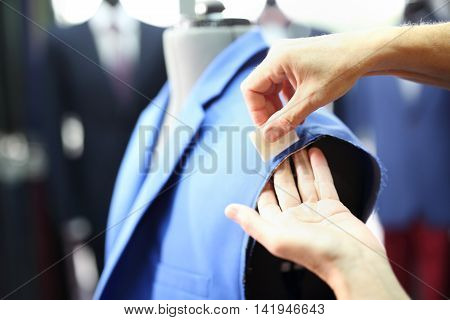 Men seamstress, a suit made to measure .