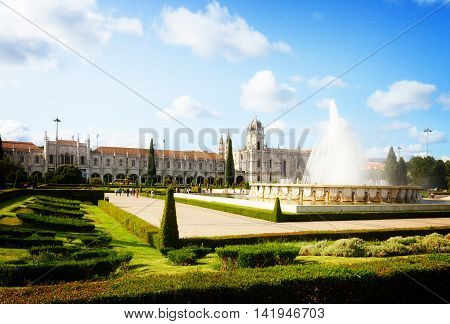 view of Mosteiro dos Jeronimos with fountain at summer day, Lisbon, Portugal, retro toned